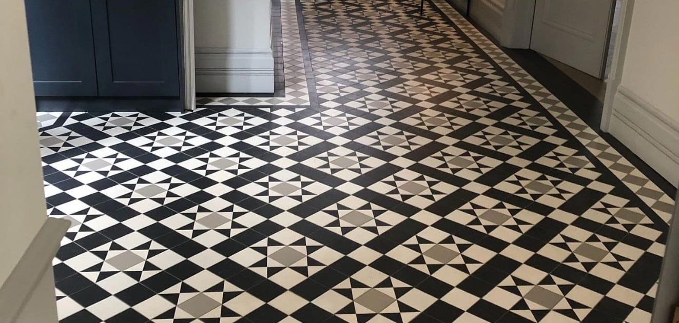 Victorian floor tiles - hallway. Tiles 10cm x 10cm thick 9mm. Colours: super white, pale grey, black.
